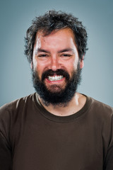 Young Man Smiling with a Dark Beard