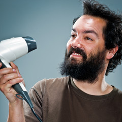 Young Happy Man with an Hair Dryer