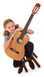 Beautiful ten year old with acoustic guitar over white with clip