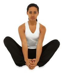 Beautiful black woman sitting yoga style over white floor eyes o