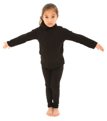 Serious Hispanic Preschooler Standing arms outstretched on White