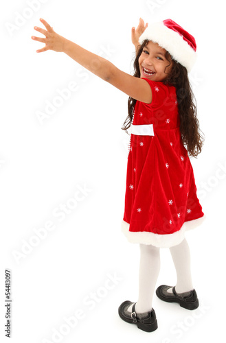 Adorable hispanic preschooler reaching out. Wearing christmas dr
