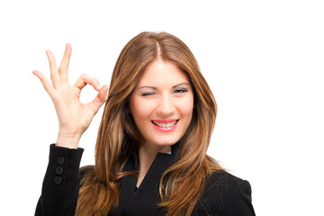 Businesswoman showing ok sign isolated on white