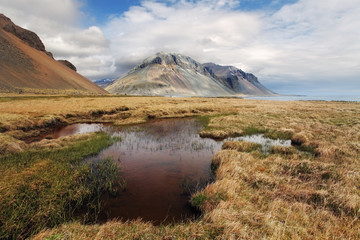 South east Iceland mountain with water