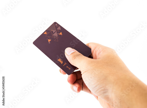 Hand Holding Up Security Clearance key Card isolated on white