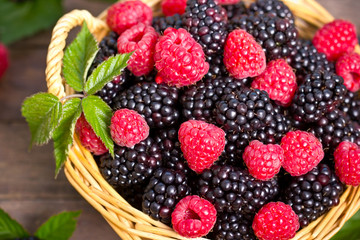 Raspberry and blackberry in the basket