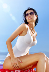 beautiful woman in white swimming suit