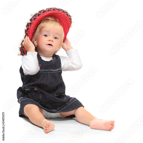 Little girl in red sombrero.