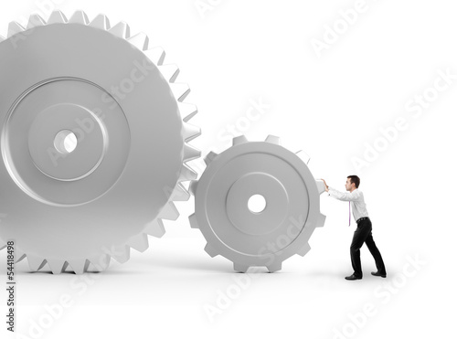 man pushing a gears