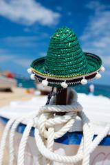Green Spanish straw hat at beach
