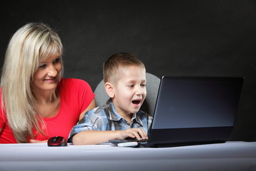 mother with son looking on the laptop