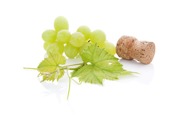 Wine cork and grapes.