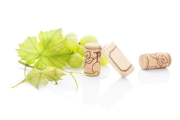 Green grapes and wine corks