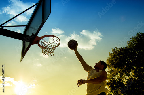 Poszter Basketball player silhouette at sunset