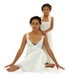 Beautiful black mother daughter portrait in white on white with