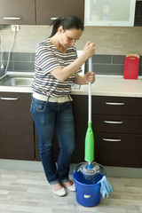Woman squeezing mop