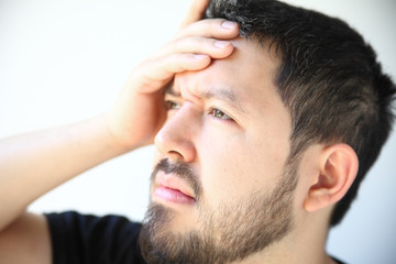 man in his thirties with a bad headache