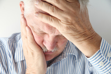 mature man has severe headache
