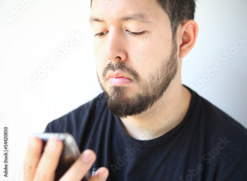 man looking down at his smartphone
