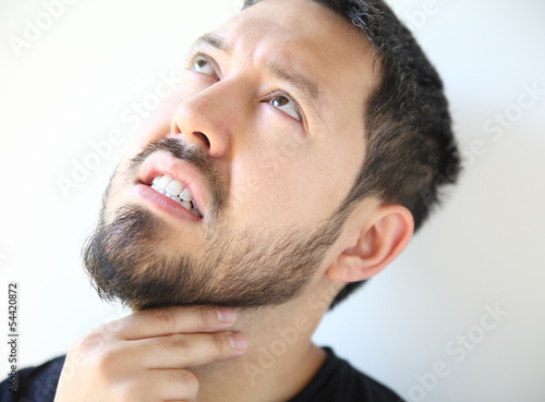 bearded young man with a sore throat