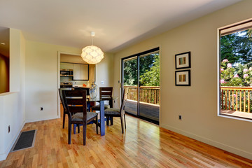 Large open space with dining room table and balcony door.