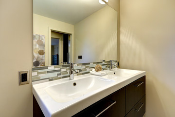 Modern bathroom large double white sink with mirror.