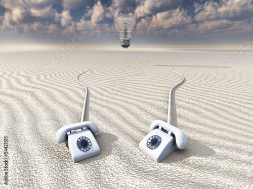 white retro phones in desert with hovering bulb