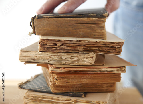 hand of a man on old books