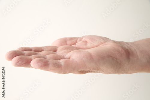man holds his hand palm up