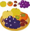 カゴに盛られた秋の果物