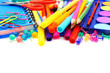 Border of colorful school supplies over white