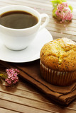 Delicious poppy seed muffins with a cup of coffee