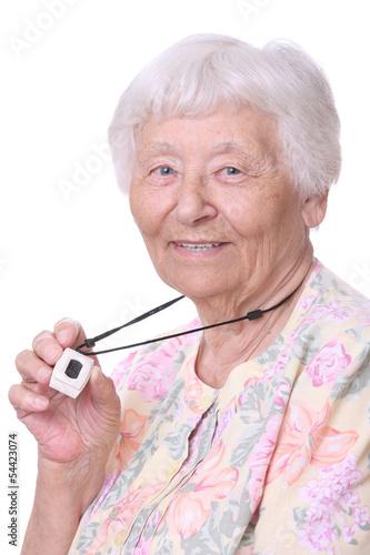 Senior woman wearing a medical emergency panic button pendant