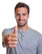 Latin man showing thumb
