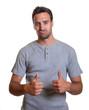 Cool latin guy showing both thumbs