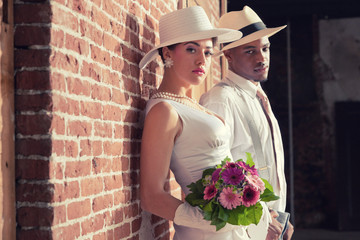 Vintage fashion romantic wedding couple in old urban building. M