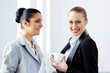 Two attractive business women smiling