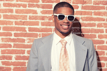 Vintage fashion cool afro american groom with sunglasses against