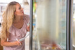 Young woman shopping at supermarket