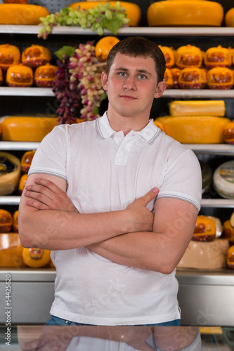 Handsome male owner of a cheese store