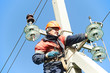 power electrician lineman at work on pole - 54426222