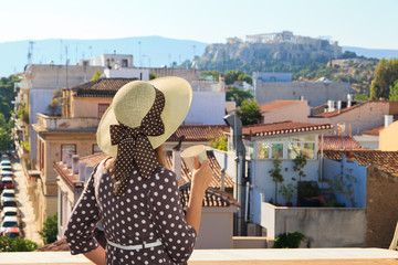 young woman looking at Acropolis, travel concept