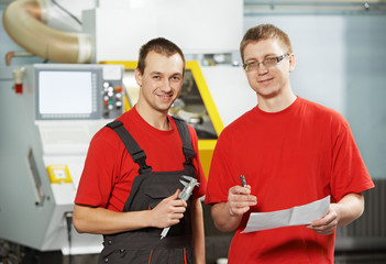 industrial workers at tool workshop