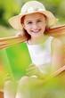 Summer joy - girl with book resting on a hammock