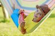 Summer joy - happy girl with  watermelon in hammock