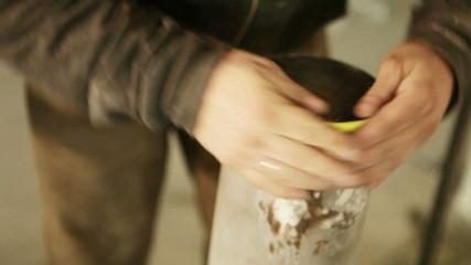 Handling abrasive metal surface