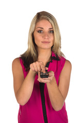 Young woman with remote control