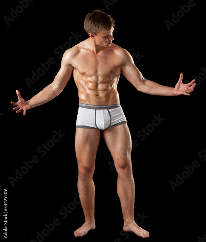 young bodybuilder demonstrates posture