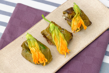 Greek dolmades wrapped with vine leaves and rice