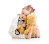 child with clothes of doctor playing toy